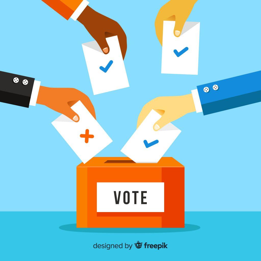 Personas votando